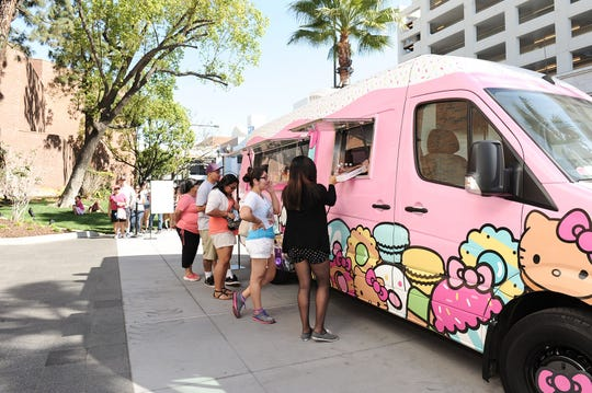 Fans line up for the Hello Kitty Cafe Truck experience.