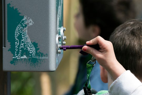A young girl uses her zoo key at the Philadelphia Zoo Thursday, April 4, 2019.