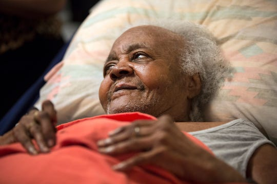 Mary Page, 99, a long-time West End resident on Wade Street is facing displacement from her home because of the new FC Cincinnati stadium. Fight Back Cincinnati: Wade street and Central Avenue Tenants United, held a press conference in her small studio apartment Tuesday, April 9, 2019. Paige said she doesn't want to leave. She said she can't walk and is confined to her bed. Her building will overlook the new stadium.