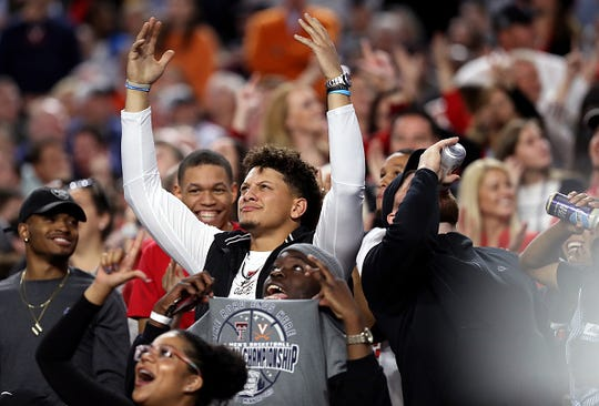 NFL players Patrick Mahomes and  Travis Kelce attend the 2019 NCAA men's Final Four National Championship game between the Virginia Cavaliers and the Texas Tech Red Raiders at U.S. Bank Stadium on April 08, 2019 in Minneapolis, Minnesota.
