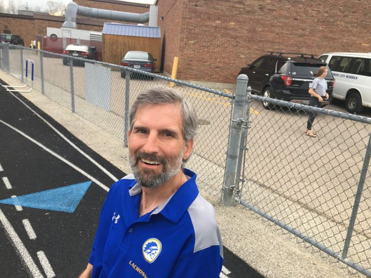 Mariemont's Graham Harden smiles before the Warriors game with Moeller April 9. Harden has battled ALS for 31 months and continues to assist both the boys and girls lacrosse programs at Mariemont.