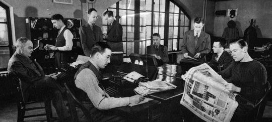 "The Local Room is the ""nerve center"" of the Editorial Department, where reporters assemble and type their stories. Here are editors, too, since in journalism all editors are reporters. Left to right, reading clockwise: H.L. Brown, Jr., (pencil on paper), Joseph Garretson, Jr., Fred E. Morgener, Bentley (""my Nite Out"") Stegner, Glenn Thompson, Philip E. Lawwill, Real Estate Editor; Paul R. Lugannani, James T. Golden, Jr., Book review Editor, and Andrew G. Foppe, Radio Editor. (Insert) Joseph B. Murphy, Norwood reporter."