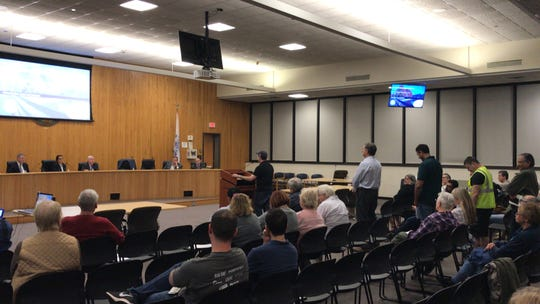 Edison residents ask questions at the second public hearing regarding the $811 million deal between the township and Suez North American on April 8 in council chambers.