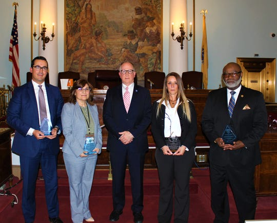"""(Left to right)Union County Prosecutor's Office Assistant Prosecutor Armando Suarez, Multidisciplinary Team Coordinator and Victim-Witness Advocate Maria Acosta, acting Union County Prosecutor Michael A. Monahan, Sgt. Margarita """"Maggie"""" D'Avella, and Capt. Harvey Barnwell appear in the Union County Courthouse during the Office's National Crime Victims' Rights Week award ceremony on Monday, April 8."""