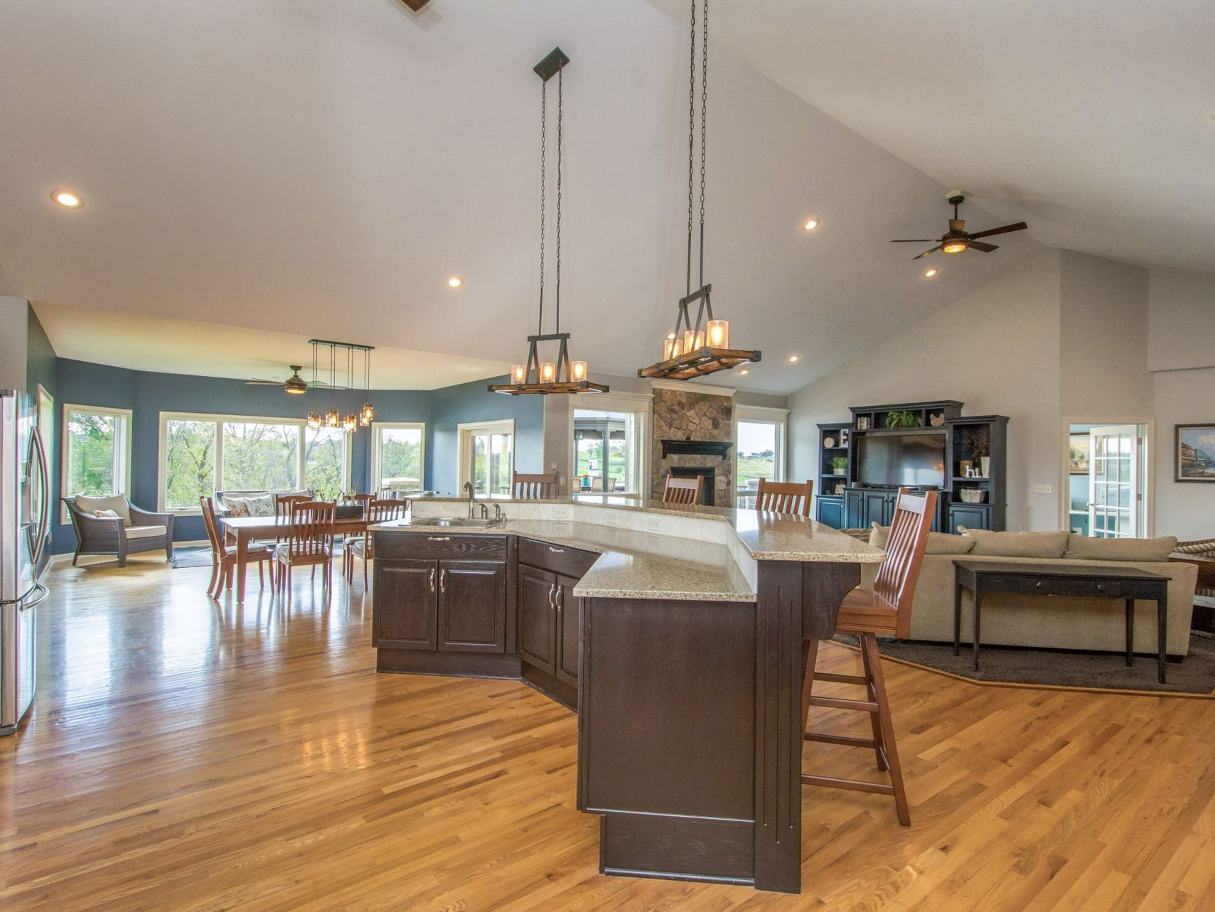 This massive home has it all, including a theater room, craft room, sunroom, exercise room and second full kitchen and bar.