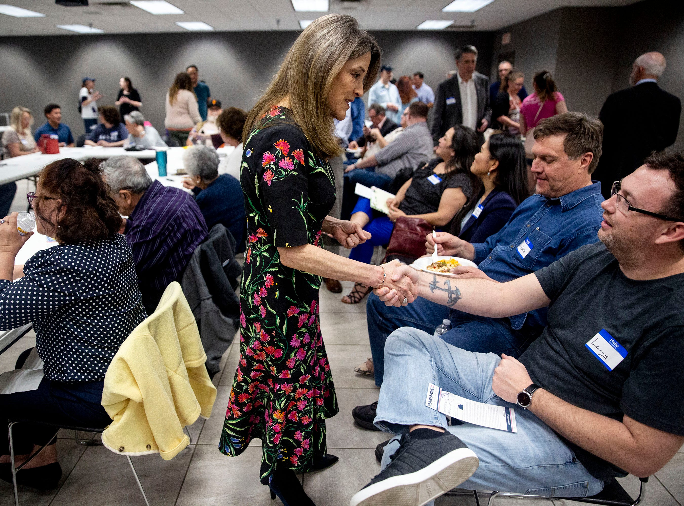 Presidential Hopeful Marianne Williamson shakes hands with people in the crowd before giving a speech to the group gathered by the Asian & Latino Coalition on Monday, April 8, 2019, in Des Moines.