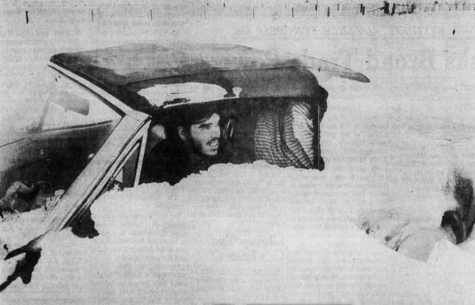 Eddie Ryan of New York, stranded during an April 1973 blizzard, watches rescue workers approach in armored personnel carriers on Interstate 80 east of Des Moines. Some parts of Iowa saw drifts as tall as 16 feet.