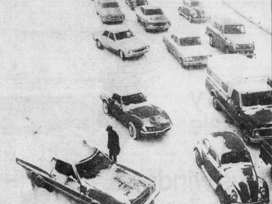 """Downtown Des Moines-bound motorists sat in their cars for 15 to 20 minutes at a time without moving an inch on the MacVicar Freeway in early April 1973 during what was called """"the worst spring storm in at least 80 years"""" by the Des Moines Register and Tribune. This view, looking west from the 56th Street overpass, shows the traffic snarl."""