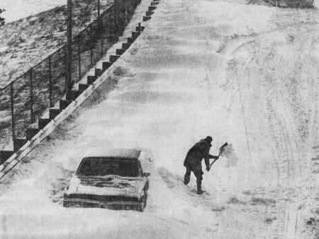 MacVicar Freeway through downtown Des Moines was nearly deserted after an early April blizzard in 1973. John Kinning of 48th Street digs his stranded car out from near the Des Moines River bridge as a lone pedestrian can be seen walking down the carless freeway.