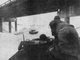 In the bright sunshine of the early morning after a two-day blizzard in April 1973, a strange vehicle headed east from Des Moines on Interstate 80. That's a National Guard armored personnel carrier on a mission to rescue storm-trapped motorists. Here Lt. Col. Richard Moss, in forward hatch, and Sgt. John Jameson approach a drift-engulfed car at the Highway 65 bypass.
