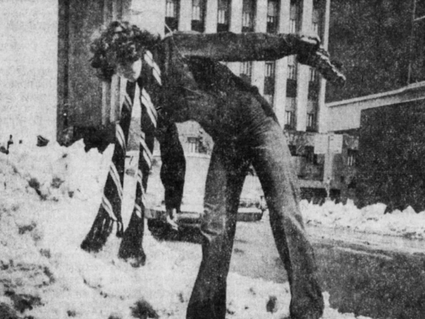 Joyce Vance, 15, walks carefully through the melting snow and slush left from an early April 1973 blizzard, on her way to the downtown Des Moines Public Library.
