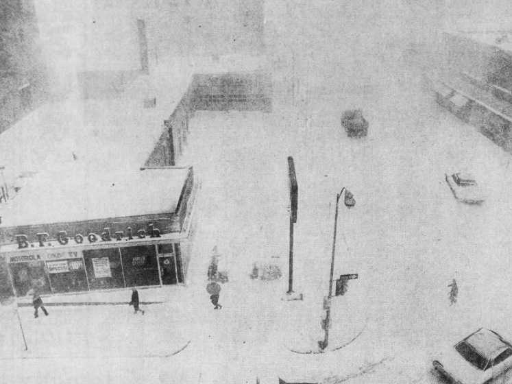 Rush hour in downtown Des Moines was anything hardly that the day after an April 1973 snowstorm. This is the view from above, looking west on Grand Avenue from 8th Street.