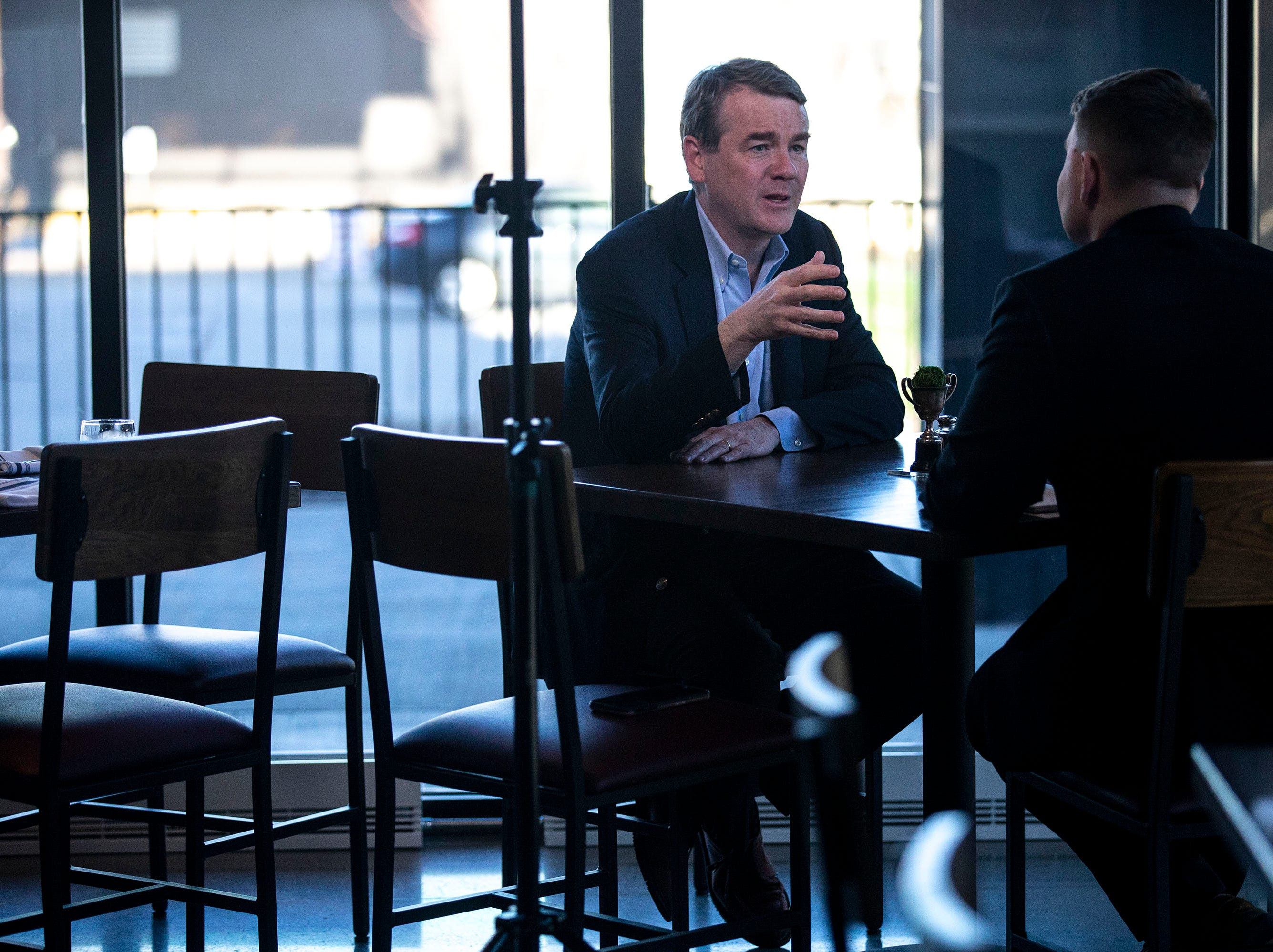 U.S. Sen. Michael Bennet, D-Colo, gives an interview before giving a speech and answering questions on Monday, April 8, 2019, during a meet and greet hosted by the Polk County Democrats at Teddy Maroon's in Des Moines.