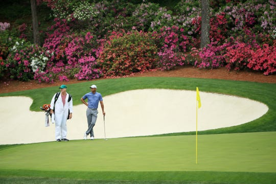 Tiger Woods and caddie Joe LaCava during a practice round prior to The Masters at Augusta National Golf Club on Monday, April 8, 2019 in Augusta, Ga.