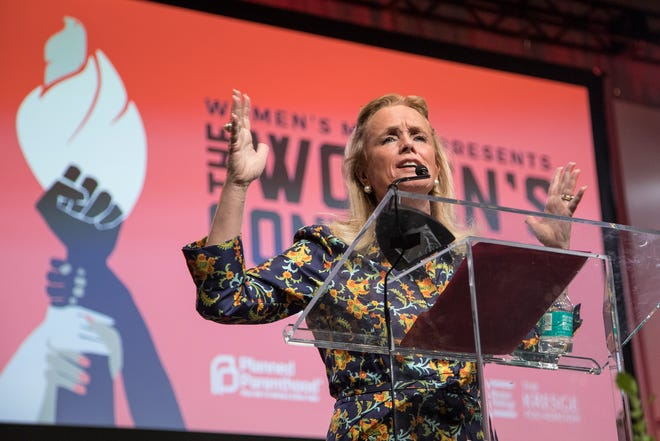 Congresswoman Debbie Dingell speaks at the Sojourner Truth Lunch of the Women's Convention at Cobo Center in Detroit in 2017.