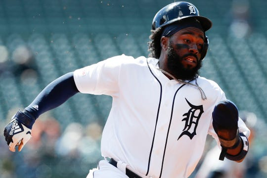 Tigers second baseman Josh Harrison rounds third base as his helmet comes loose during the first inning on Tuesday, April 9, 2019, at Comerica Park.