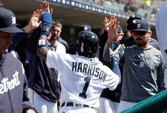 Tigers second baseman Josh Harrison is greeted in the dugout after scoring during the first inning on Tuesday, April 9, 2019, at Comerica Park.