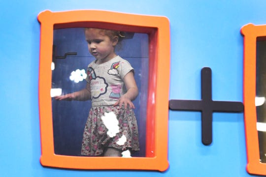 Scarlett Schwen, 2, makes her way through one of the attractions at Peppa Pig World of Play.