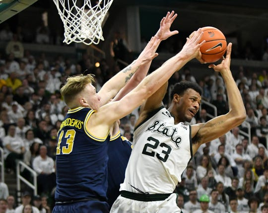 Michigan forward Ignas Brazdeikis failed to beat Michigan State and forward Xavier Tillman on three tries in 2019.
