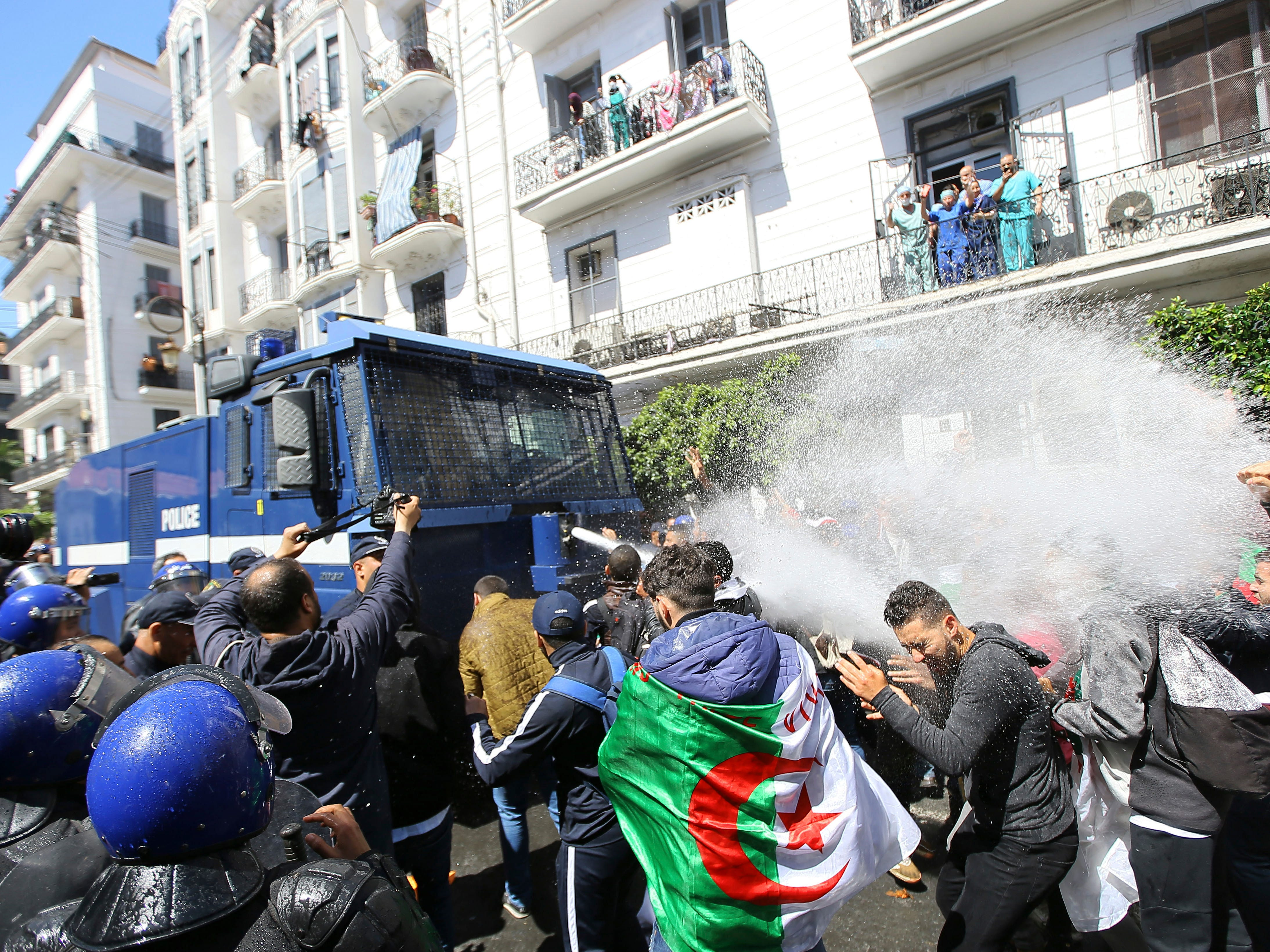 Police forces fire a water cannon at students demonstrating in Algiers, Tuesday, April 9, 2019. Algerian police have also used tear gas to disperse protesters in the capital, less than an hour after the country's parliament chose an interim leader.