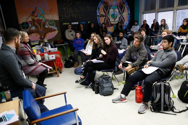 In this Thursday, Jan. 24, 2019, photo students listen as social studies teachers Judi Galasso and Jonathan Duffy lead the introductory class of their American Thought and Political Radicalism course at Thomas Worthington High School,  in Worthington, Ohio.