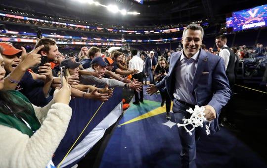 Virginia head coach Tony Bennett celebrates with fans.