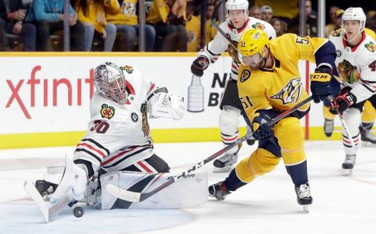 Chicago Blackhawks goaltender Cam Ward blocks a shot by Nashville Predators left wing Austin Watson on Saturday.