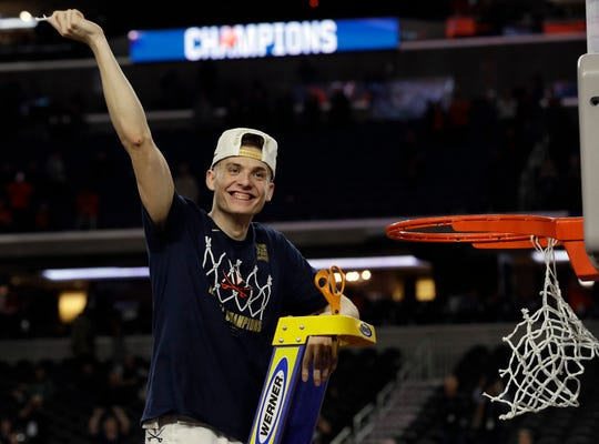 Virginia's Kyle Guy celebrate after defeating Texas Tech in overtime of the national-championship game Monday.