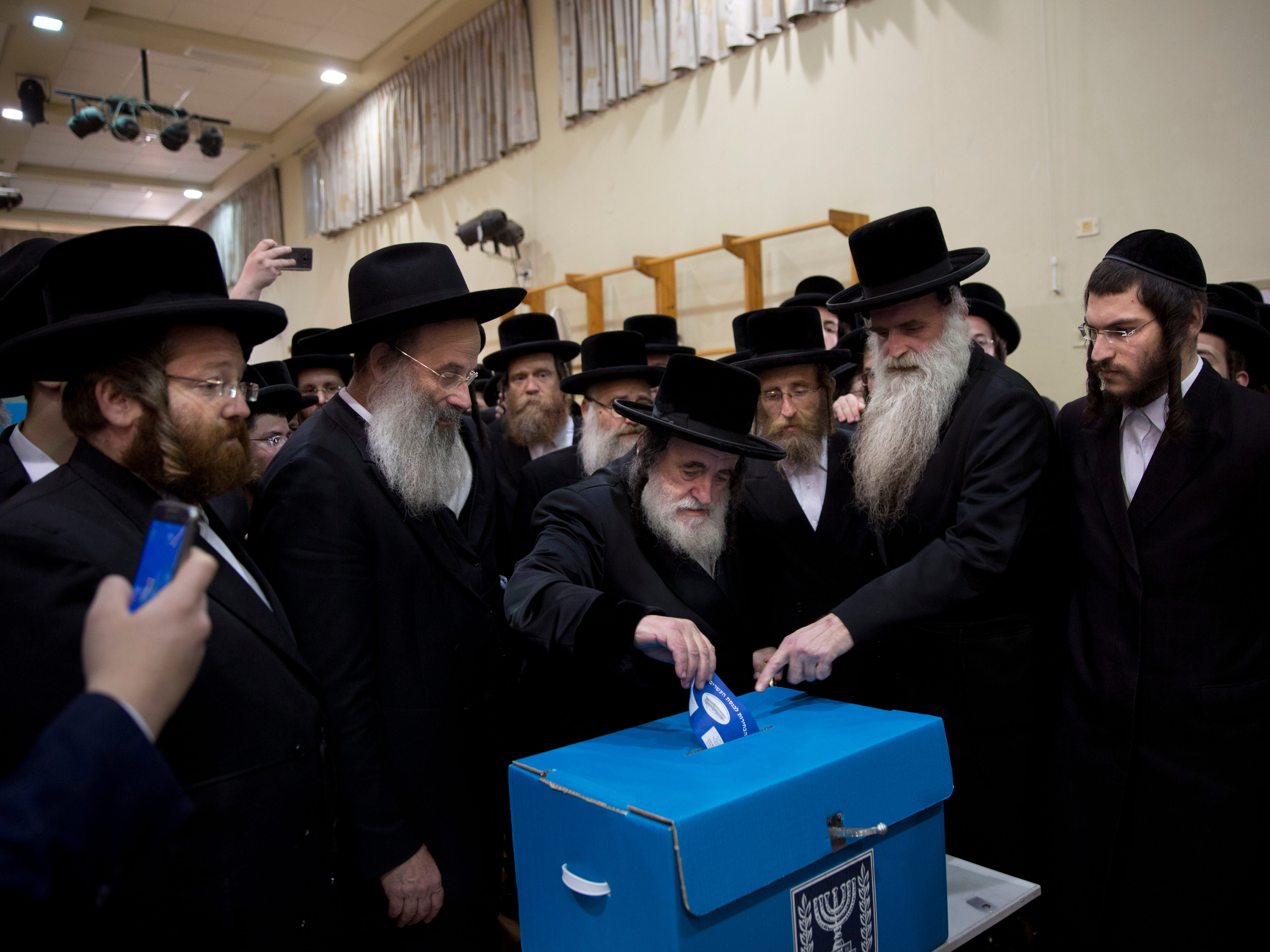 Rabbi Israel Hager votes for Israel's parliamentary election at a polling station in Bnei Brak, Israel, Tuesday, April 9, 2019.