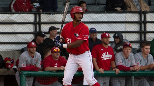 Manny Lopez bats during an exhibition with Indiana University at Bosse Field last fall.