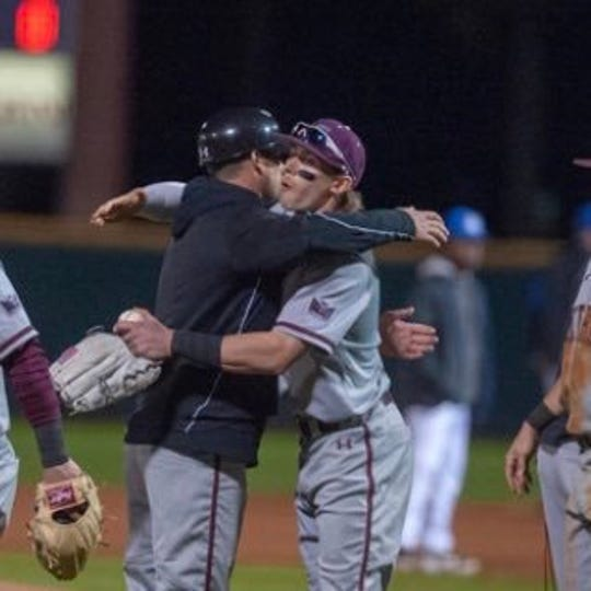 SIU hitting coach Seth LaRue hugs brother Will after a recent Saluki victory. Both are Mater Dei graduates