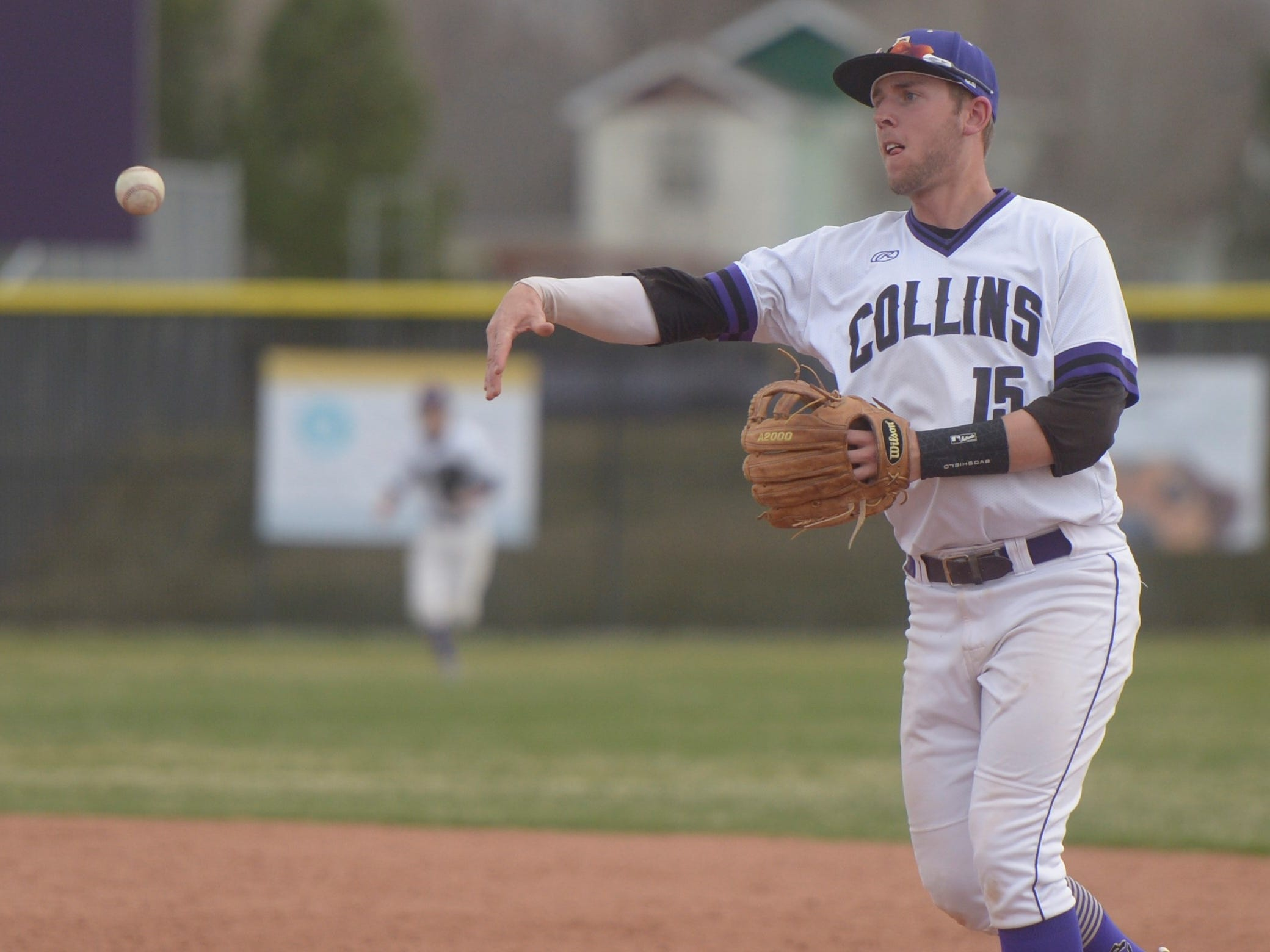 Fort Collins High School baseball second baseman Caleb Brlecic throws to first during a game against Denver South on Monday, April 8, 2019. The Lambkins won 13-3 to move to 10-0 on the season.