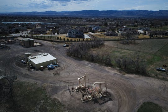 Two pumpjacks are seen on Friday, April 4, 2019,  just east of the Hearthfire neighborhood in Fort Collins, Colo. This photograph was taken with the Coloradoan's drone.