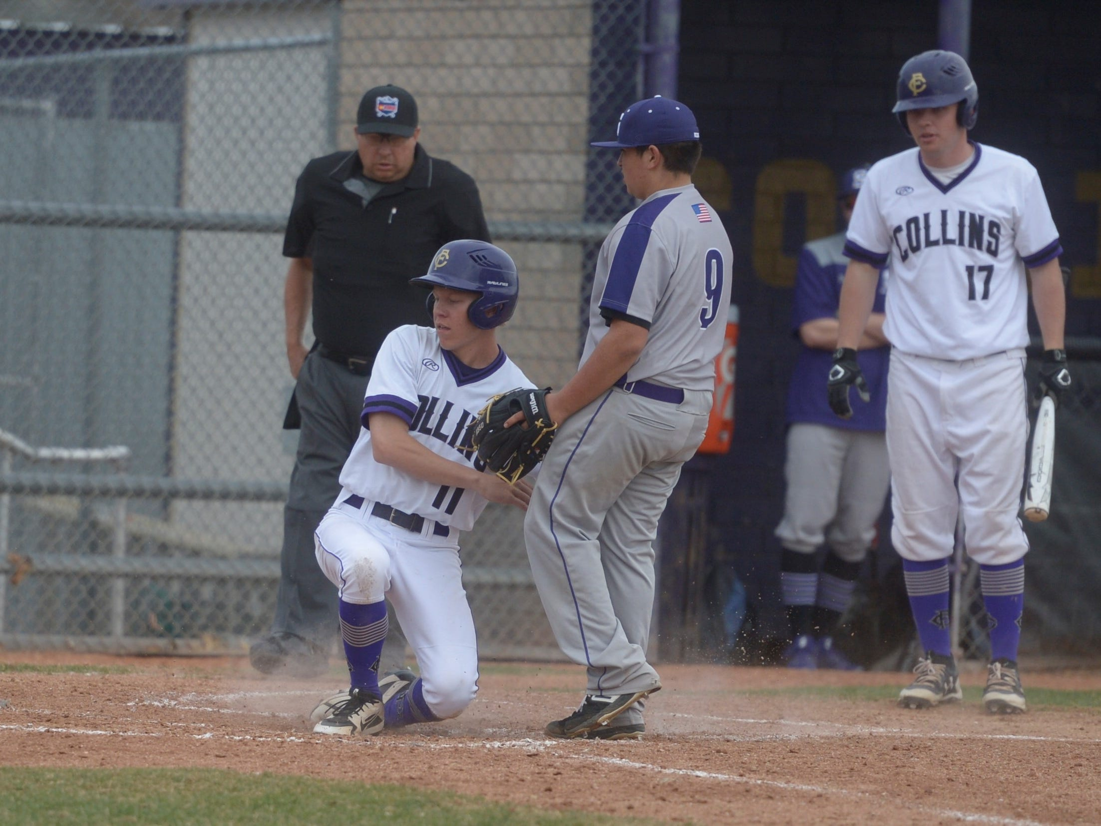 Fort Collins High School baseball player Matthew Oberlander slides into home during a game against Denver South on Monday, April 8, 2019. The Lambkins won 13-3 to move to 10-0 on the season.