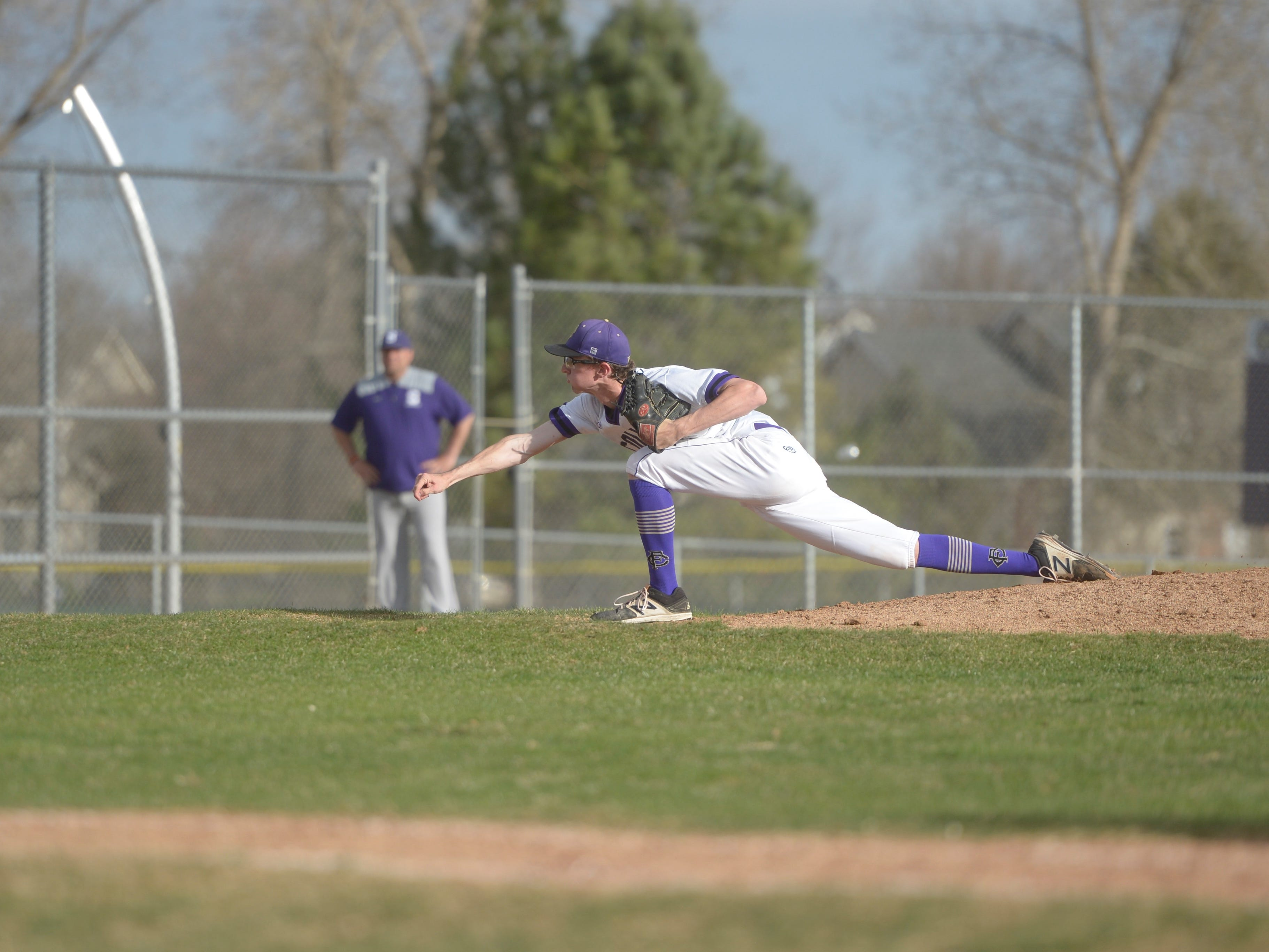 Fort Collins High School sidearm pitcher Cooper Brotherton pitches during a game against Denver South on Monday, April 8, 2019. The Lambkins won 13-3 to move to 10-0 on the season.