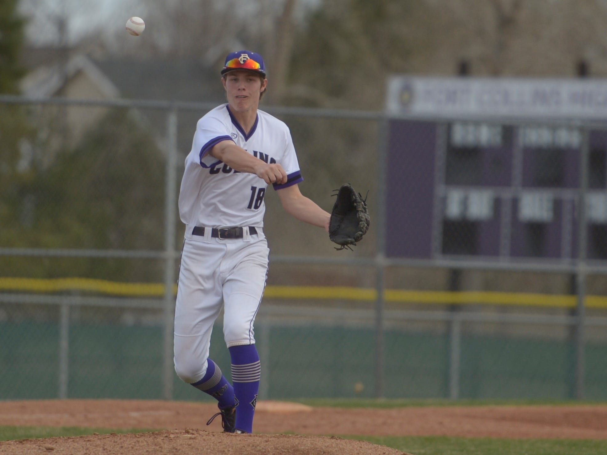 Fort Collins High School baseball third baseman Hayden Iverson throws to first during a game against Denver South on Monday, April 8, 2019. The Lambkins won 13-3 to move to 10-0 on the season.