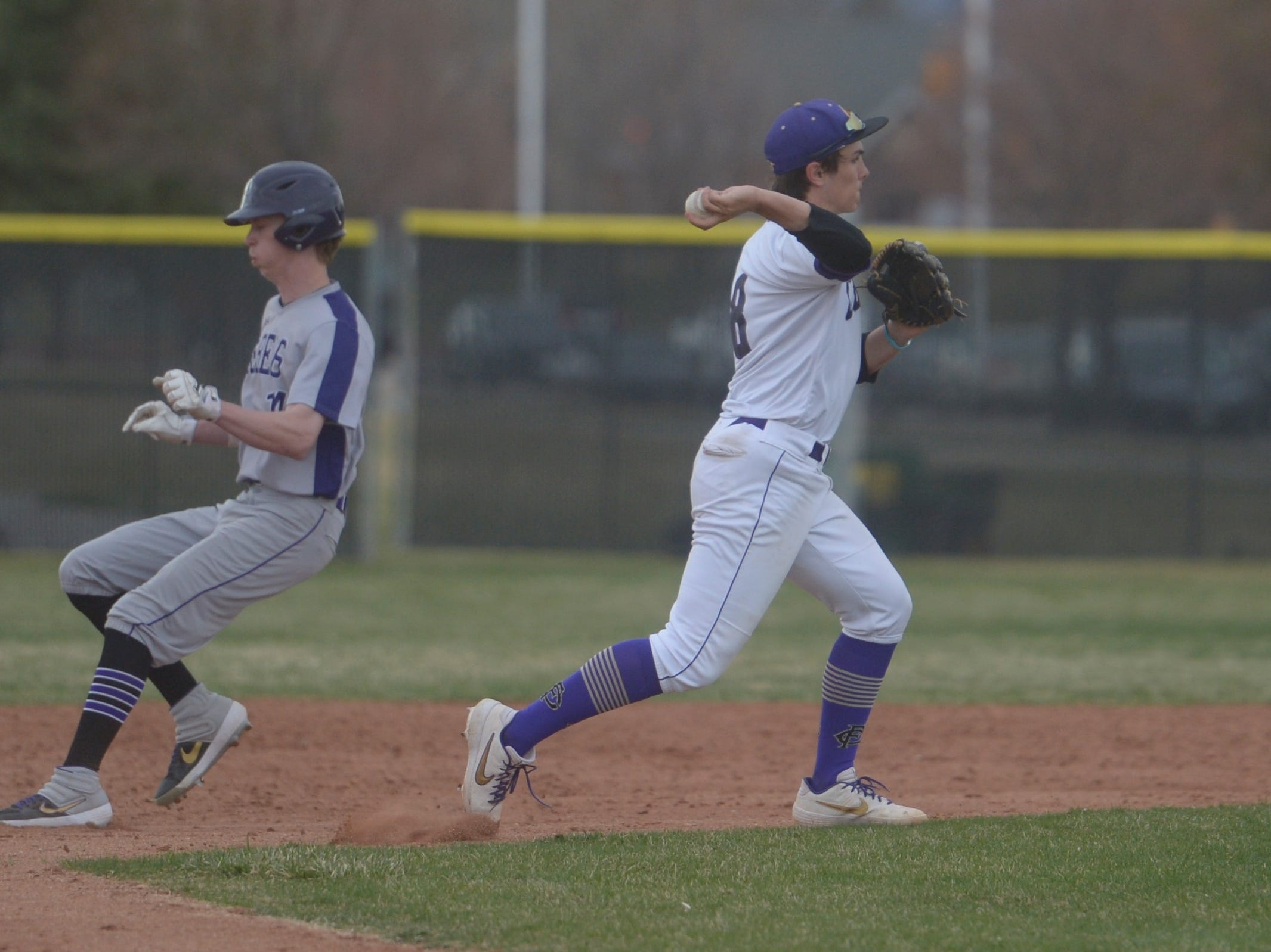 Fort Collins High School shortstop Blake Templeton throws to first during a game against Denver South on Monday, April 8, 2019. The Lambkins won 13-3 to move to 10-0 on the season.