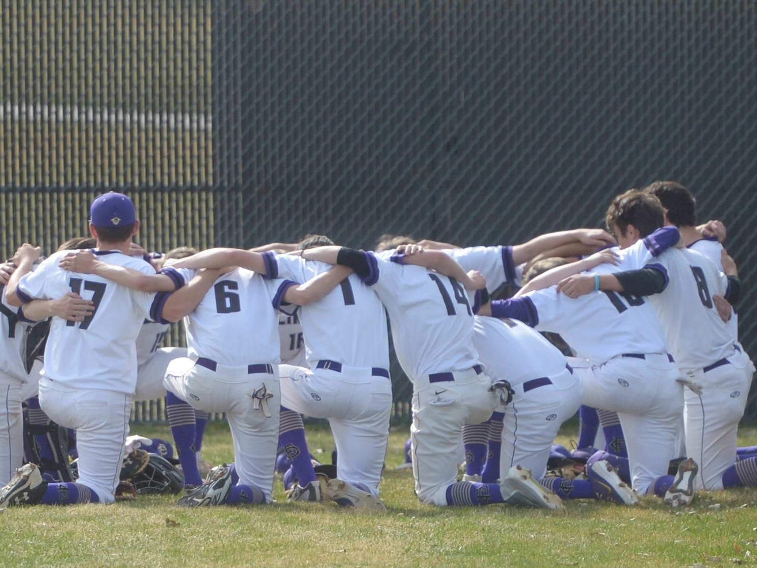 The Fort Collins baseball team huddles before Monday's game against Denver South. The Lambkins won 13-3 to move to 10-0 on the season.