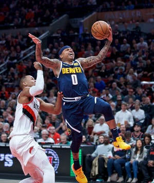 Isaiah Thomas, shown putting up a shot Sunday in a game at Portland, and the Denver Nuggets will host the Minnesota Timberwolves at 8:30 p.m. Wednesday at the Pepsi Center.