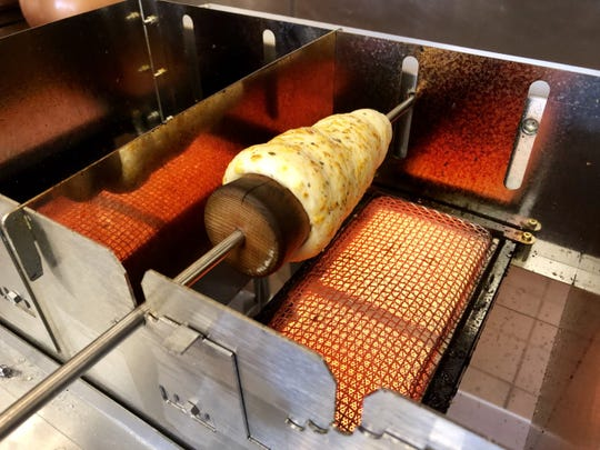 A savory, cheesy firebread bakes in the specialty ovens at Gerry's Firebread in Fort Myers.