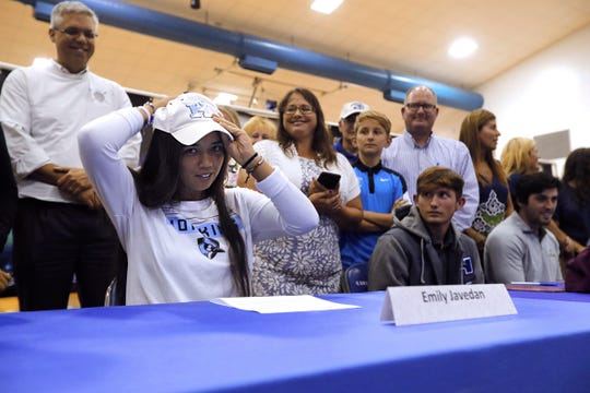 Canterbury School tennis player Emily Javedan puts on a Johns Hopkins University cap during a signing ceremony Tuesday morning, April 9, 2109.