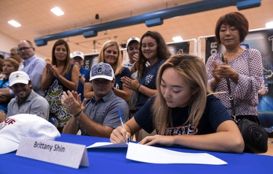 Canterbury School golf player Brittany Shin, signs a document Tuesday morning, April 9, 2109, during a group signing ceremony. Shin will be attending Cal State Fullerton.