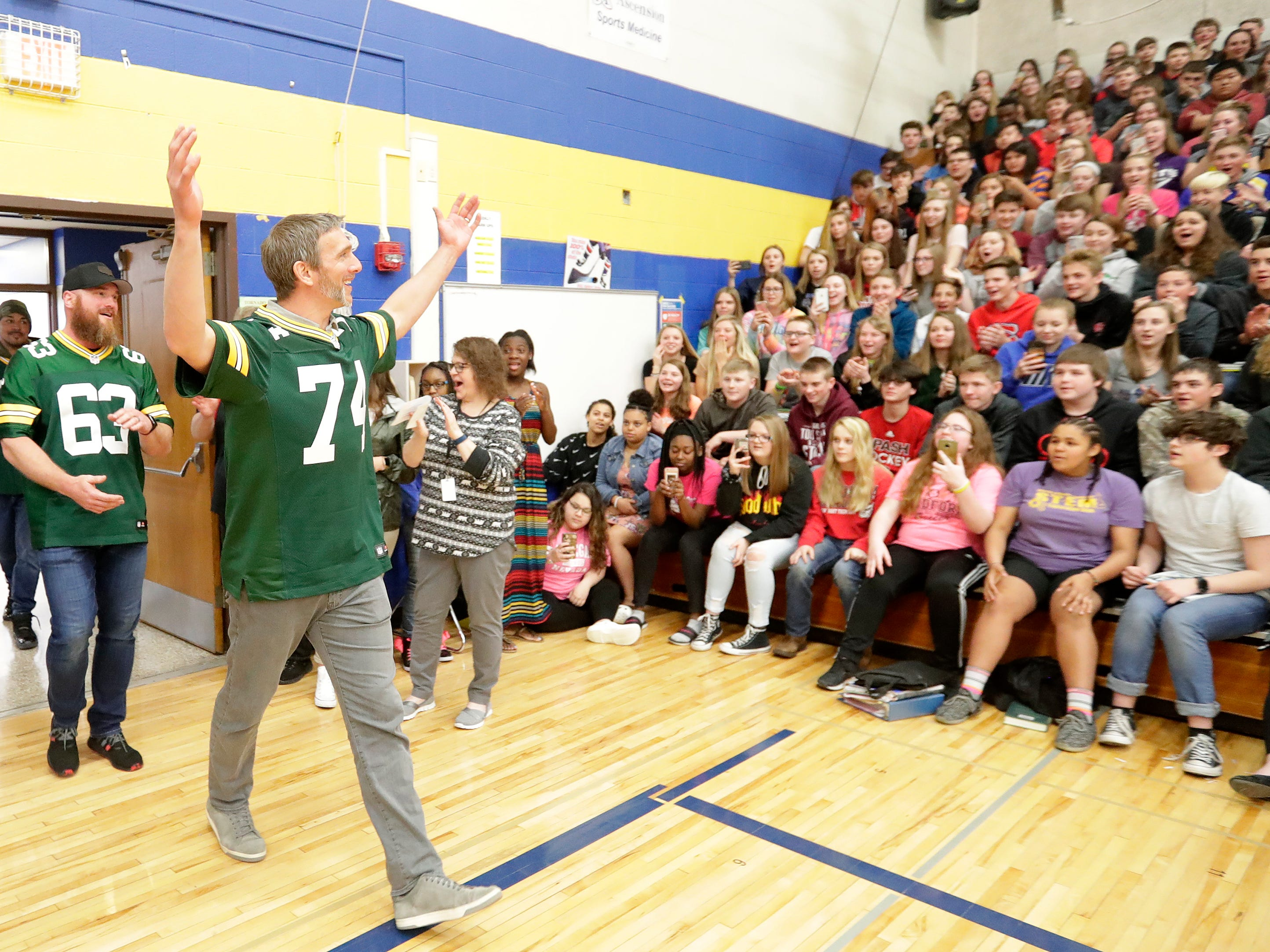 Former Green Bay Packers players Aaron Kampman and Scott Wells arrive for a stop on the Packers Tailgate Tour at Ben Franklin Junior High High School on Tuesday, April 9, 2019 in Stevens Point, Wis.