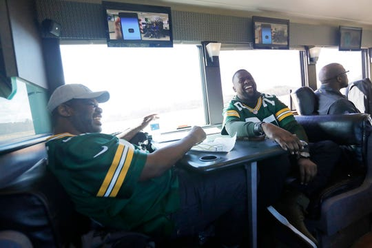 Former Green Bay Packers players Bernardo Harris (left) and Earl Dotson joke in between stops on the Packers Tailgate Tour on Tuesday, April 9, 2019 in Clintonville, Wis.