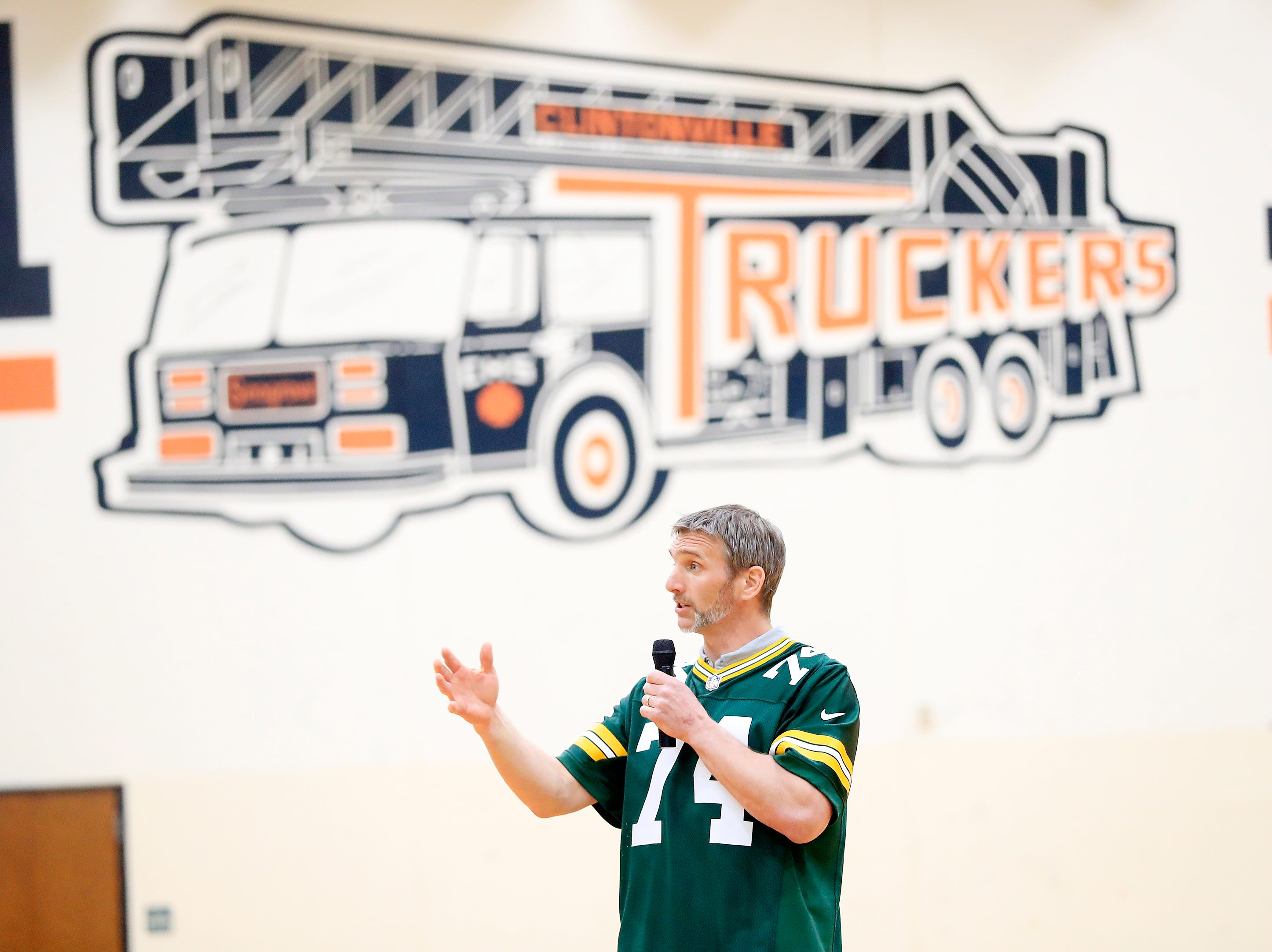 Former Green Bay Packers player Aaron Kampman talks during a stop on the Packers Tailgate Tour at Clintonville High School on Tuesday, April 9, 2019 in Clintonville, Wis.