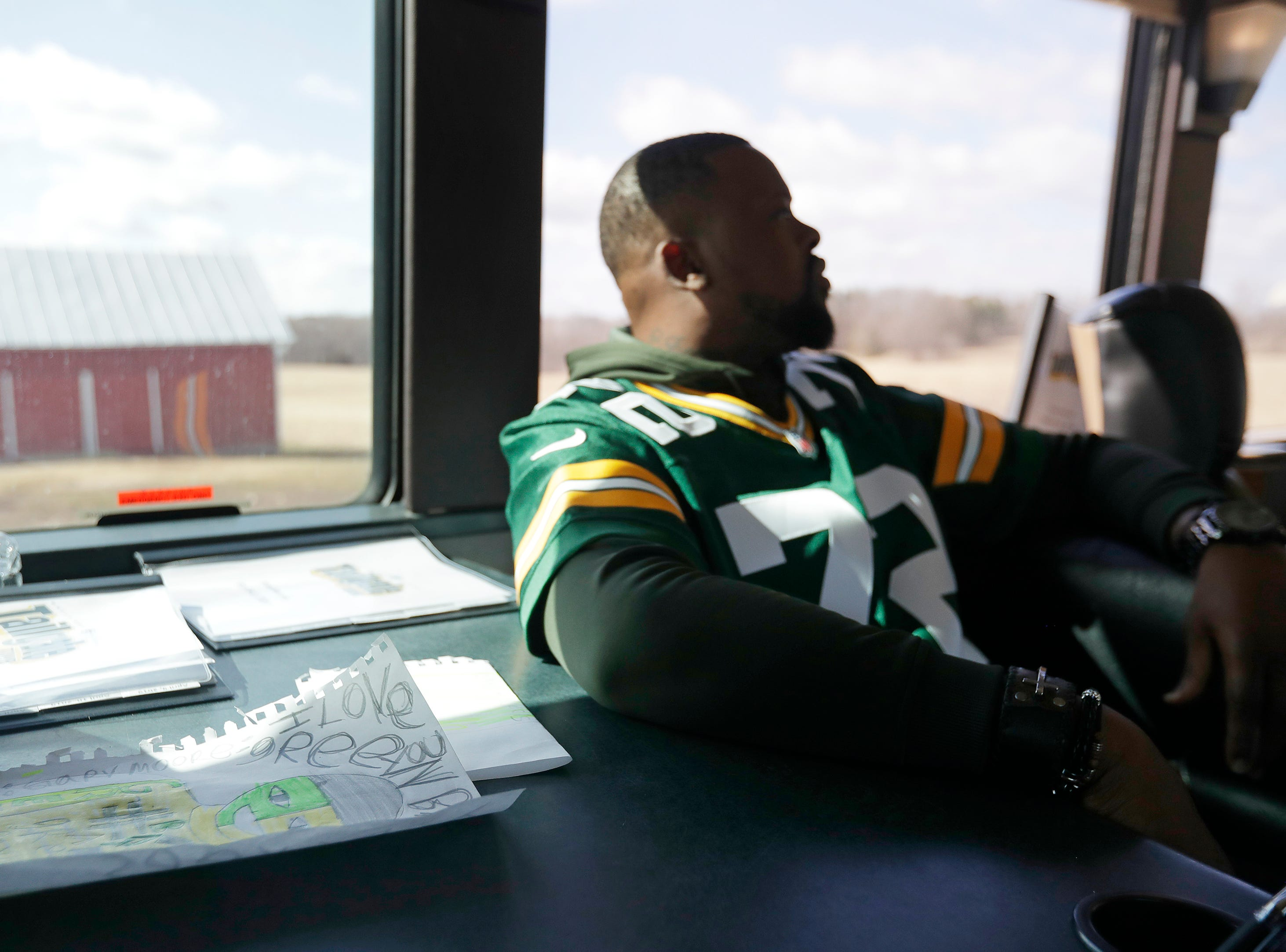 Packers-themed art sits on a table as former player Earl Dotson rides to a stop on the Green Bay Packers bus during the Packers Tailgate Tour on Tuesday, April 9, 2019 in Clintonville, Wis.