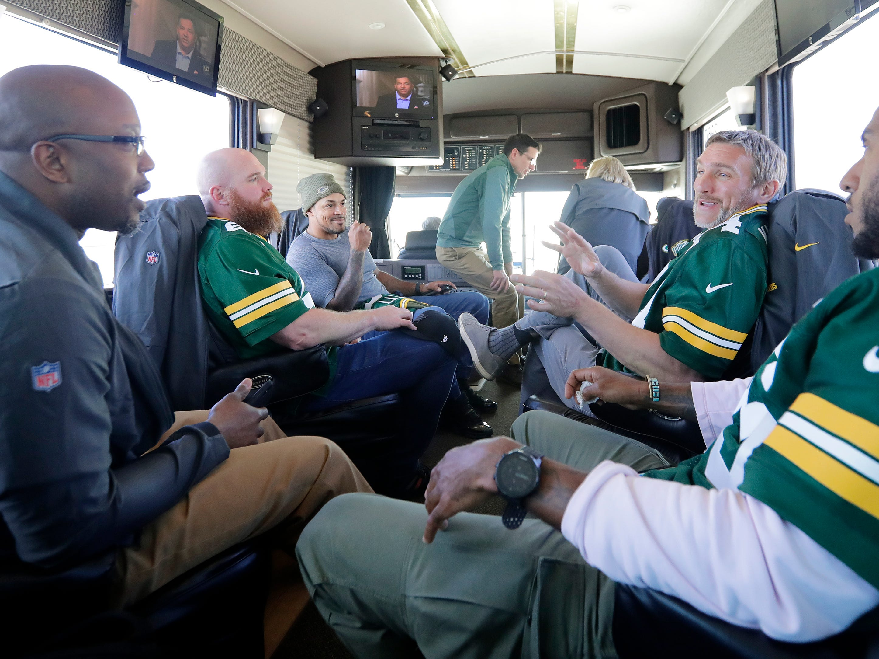 Former Green Bay Packers player Aaron Kampman talks on the bus between stops on the Packers Tailgate Tour on Tuesday, April 9, 2019 in Clintonville, Wis.
