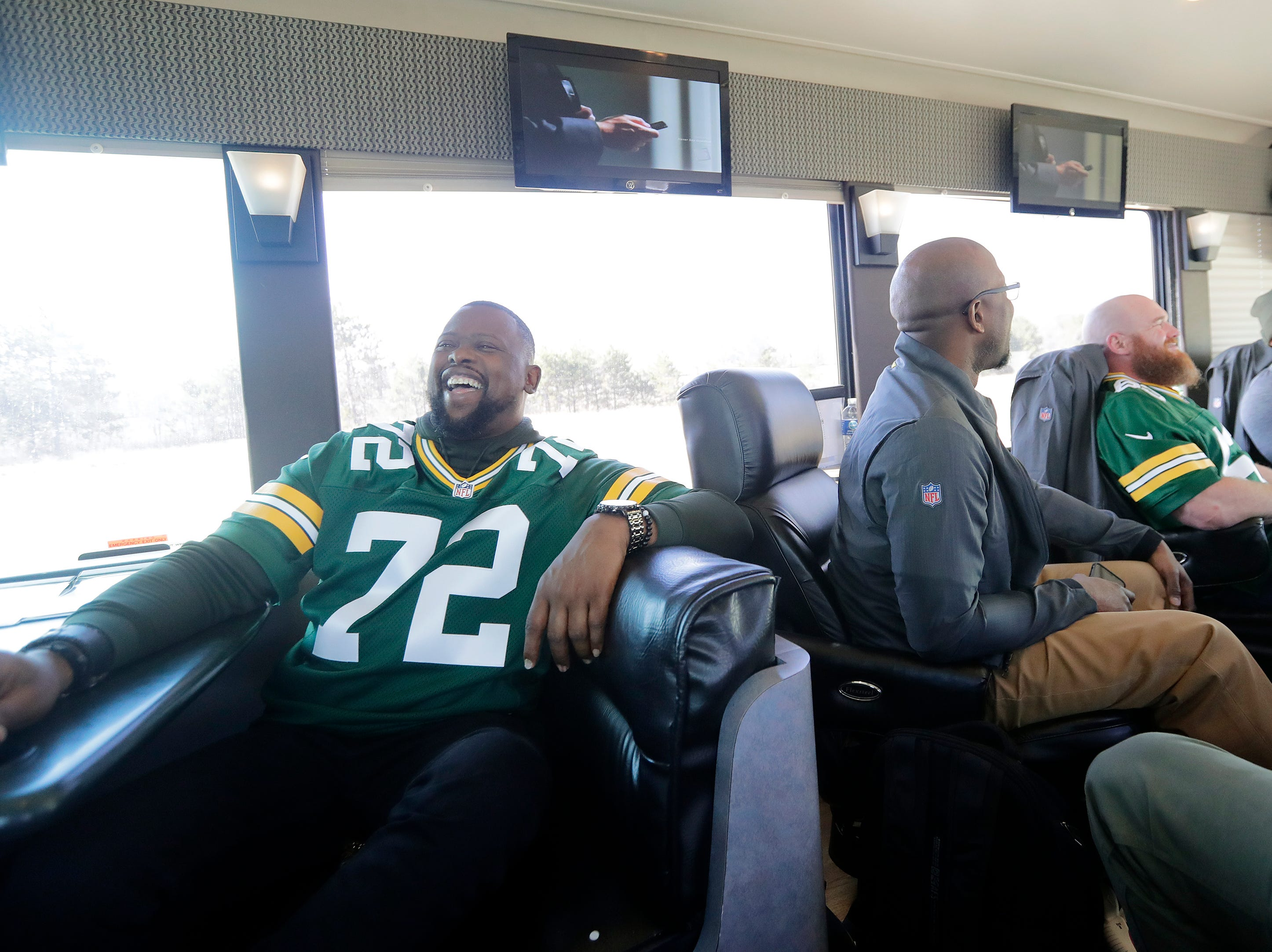 Former Green Bay Packers player Earl Dotson jokes in between stops on the Packers Tailgate Tour on Tuesday, April 9, 2019 in Clintonville, Wis.