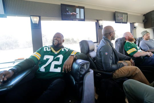 Former Green Bay Packers player Earl Dotson jokes in between stops on the 2019 Packers Tailgate Tour in Clintonville.