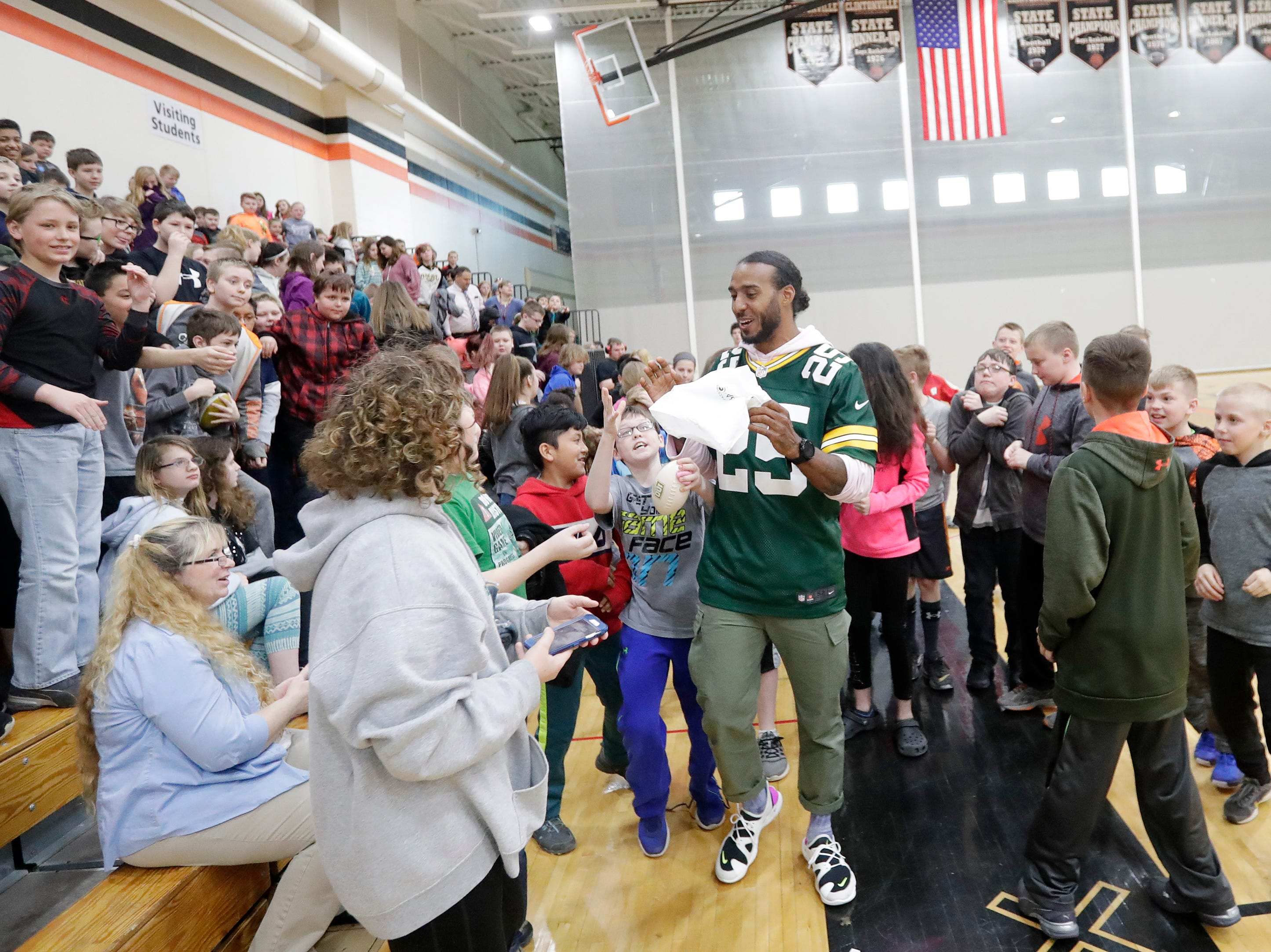 Former Green Bay Packers player Ryan Grant interacts with kids during a stop on the Packers Tailgate Tour at Clintonville High School on Tuesday, April 9, 2019 in Clintonville, Wis.